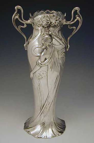 WMF   Designer    Description Silver Plate on pewter vase with typical art nouveau figural maiden decoration and original glass liner   Country of Manufacture Germany   Date c.1906