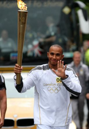 Formula One driver and torchbearer Lewis Hamilton holding the Olympic Flame before his Torch Relay leg through Luton