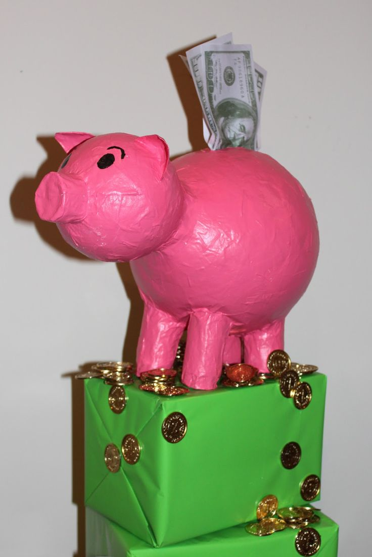 This is a paper mache piggy bank I made for a library display featuring novels about money.  Most of the materials I had at home.  I foun...