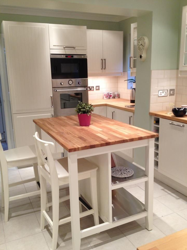Butcher block island. Perfect but with stools and seating on both ...