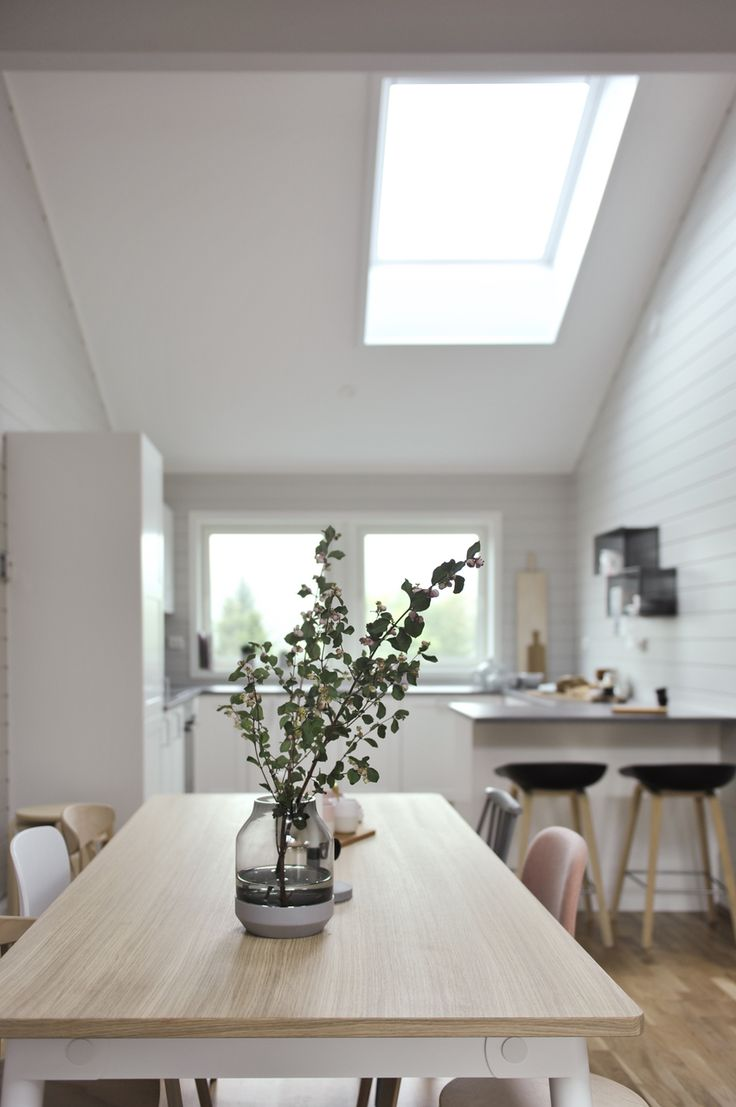 scandinavian style home extension with roof window. how to increase natural light in my kitchen
