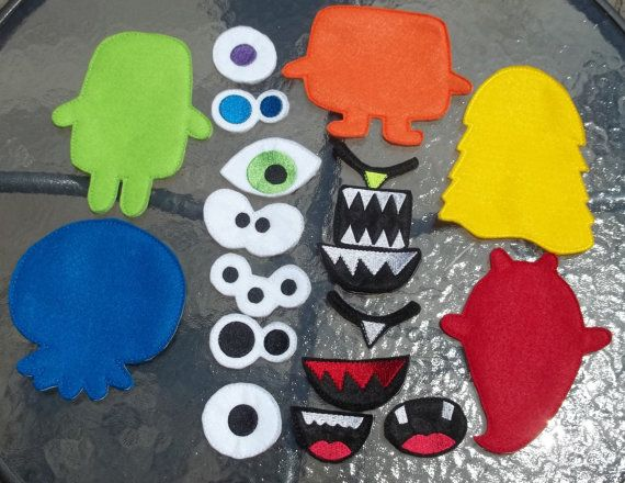 This embroidered build a monster game is a game that will give your child hours of fun time. This is a busy page to be added to your custom made busy book. The front of the bag has an additional monster on the front and the back has a flap pocket for storage of the pieces. Holes
