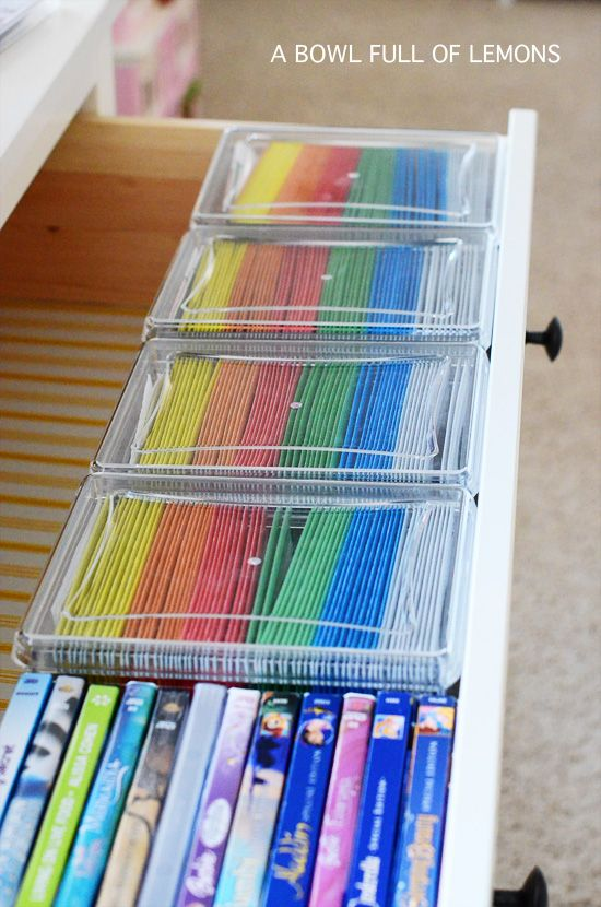 organize  movies in acrylic dvd organizers from the Container Store.   I threw out most of the cases. The boxes are organized by categories.  Box 1 – Kids movies  Box 2-4 – Mom & Dads movies