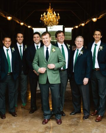 Mikey's groomsmen and ushers donned navy jackets, dark gray pants, and green knit ties. Boutonnieres of stephanotis and seeded eucalyptus were pinned to their lapels.