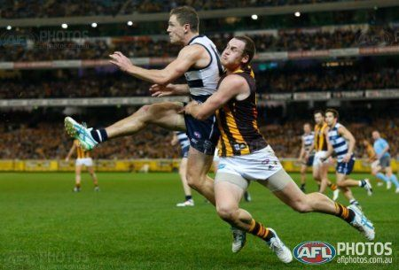 Joel Selwood of the Cats is tackled by Jarryd Roughead of the Hawks during the 2013 AFL Round 15 match between the Geelong Cats and the Hawthorn Hawks at the MCG, Melbourne on July 06, 2013. (Photo: Michael Willson/AFL Media)