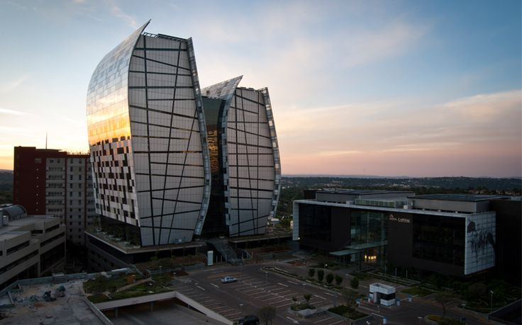 The Norton Rose Towers at 15 Alice Lane in Sandton by Paragon Architects. The dramatic glass facade is an impressive architectural addition to the skyline. #johannesburg #architecture
