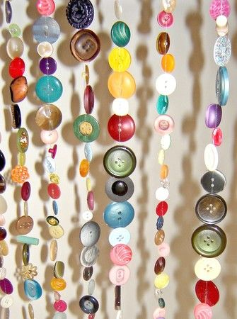button curtains - could be cool in studio window. I certainly have enough buttons!!!