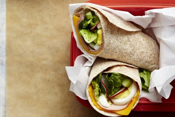 Chef's Salad Wrap - Veggies tossed with just a hint of dressing add flavour but won't make the sandwich wrap soggy. Keep it from falling apart by wrapping it tightly in plastic wrap or foil.