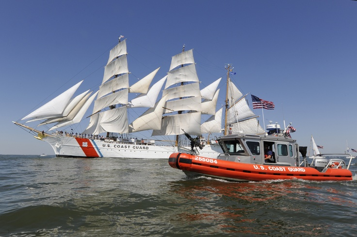 The Coast Guard Cutter Eagle, a 295-foot barque homeported in New London, Conn., participates in the Parade of Sail as a crew aboard a 25-foot Response Boat – Small provides security for the event here, June 8, 2012. The Eagle's primary mission is to train officer candidates and cadets before they enter the fleet as commissioned officers.