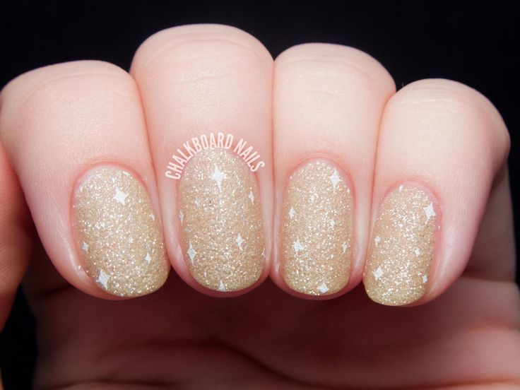 New Year's Eve means you can add as much glitz and glam as you want, and we love how Sarah of Chalkboard Nails did it with this mani. Start with a light gold glitter polish like Zoya Pixie Dust in Godiva. Once you've worn it for a few hours (or a whole day, just to be safe), get ready to stamp. Using a full-nail stamp to create the little twinkles will make it a lot easier. Try this one from Nailz Craze.