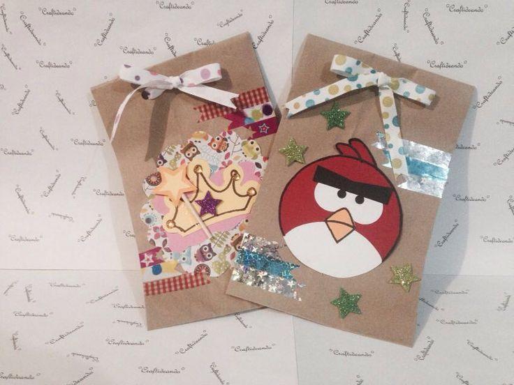 Dulceros hechos con bolsas de papel para niño y niña.