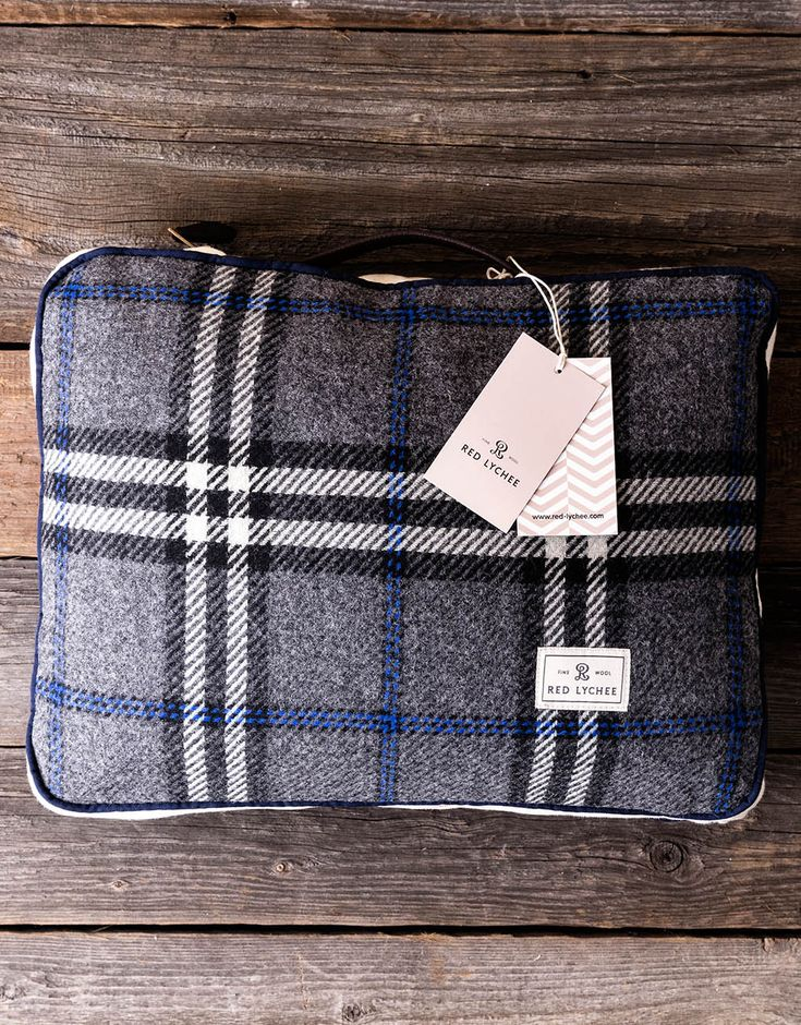 Ambassador Travel Set. It contains a warm blanket and pillow, which come in a coordinating zippered bags.