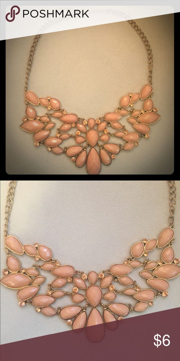 Pink statement necklace Perfect accent piece. Pairs well with booties and a basic shirt. Has a tiny gem missing towards the middle. Not noticeable at all! Jewelry Necklaces