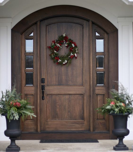 I'm sort of in love with this door.  The dark wood and the white pillars that support the porch.  I would have sidelights made all of glass, though.
