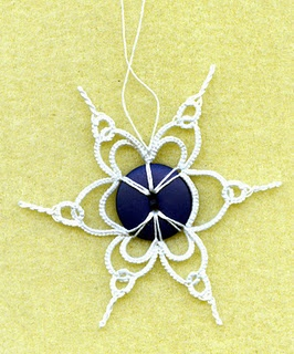 Tatted snowflake with bead.