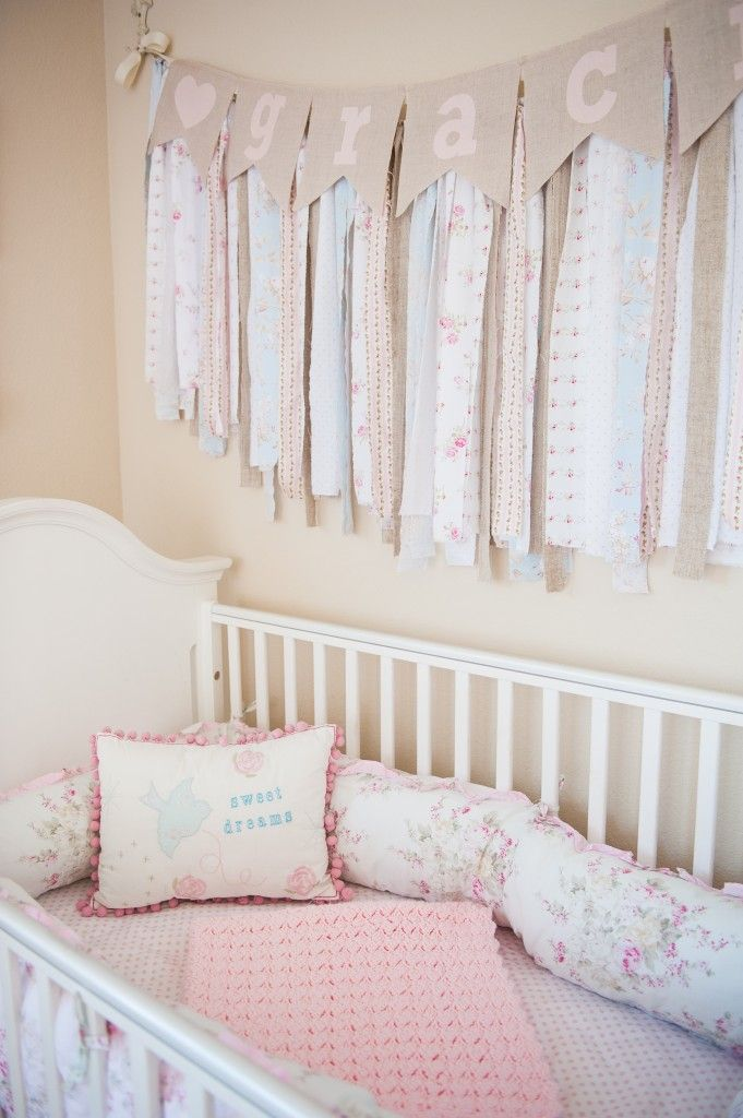 Shabby Chic Nursery - love the fabric garland over the crib! {Always remember to hang high enough so baby can't grab!}