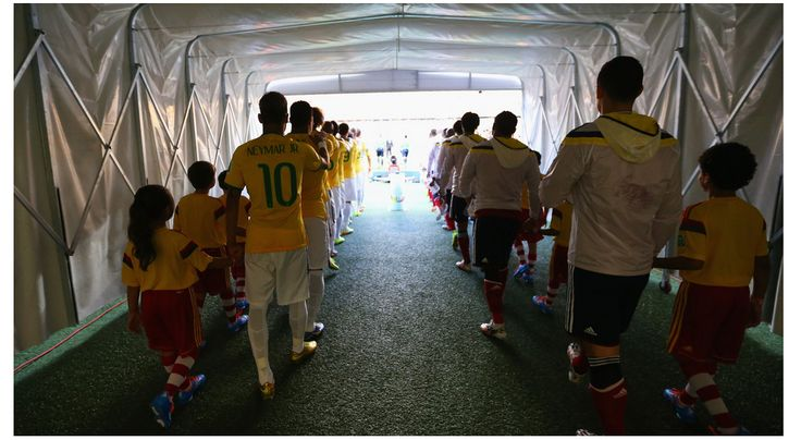 Players walk in the tunnel on to the pitch Friday, 4 July 2014 FORTALEZA, BRAZIL - JULY 04: Players walk in the tunnel on to the pitch prior to the 2014 FIFA World Cup Brazil Quarter Final match between Brazil and Colombia at Estadio Castelao on July 4, 2014 in Fortaleza, Brazil.