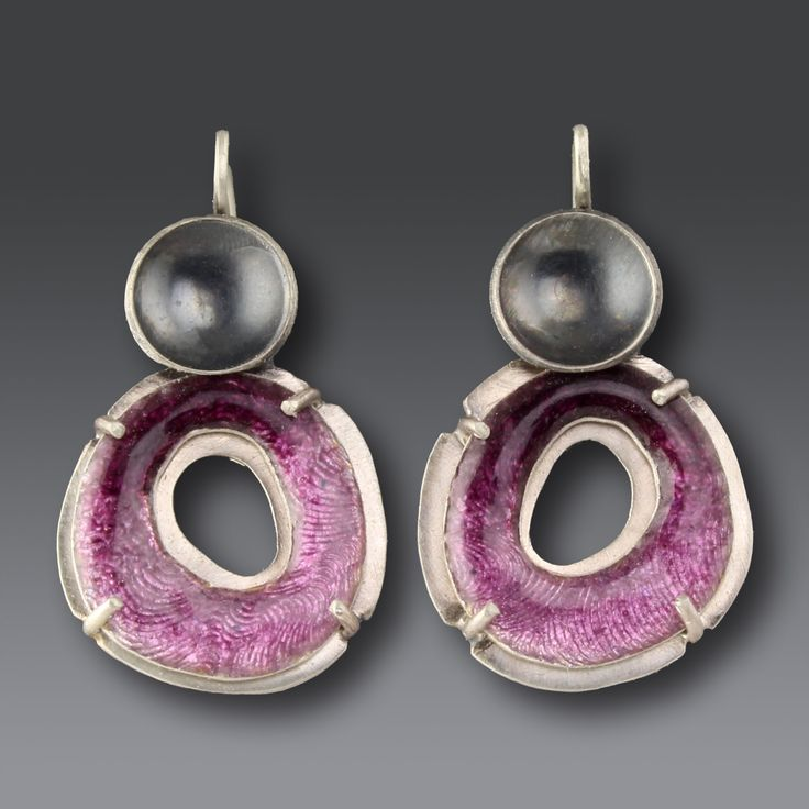 Fat Circle Earrings by Jennifer Park. These drop earrings feature enamel with silver. The enamel is held in place with silver prongs. The two-toned finish of bright and oxidized silver adds drama. Clean with mild soap and water; no abrasives.
