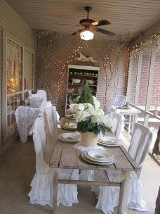 How pretty!  This reminds me of our covered porch.  I'd love to turn it into a sunroom someday and do something like this.