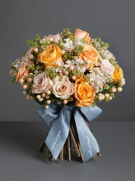 Ambre Bouquet. (Beautiful! I really like the blue ribbon with the golden flowers)
