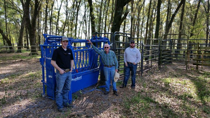Jason and Derek help set up a cattle working system in Florida