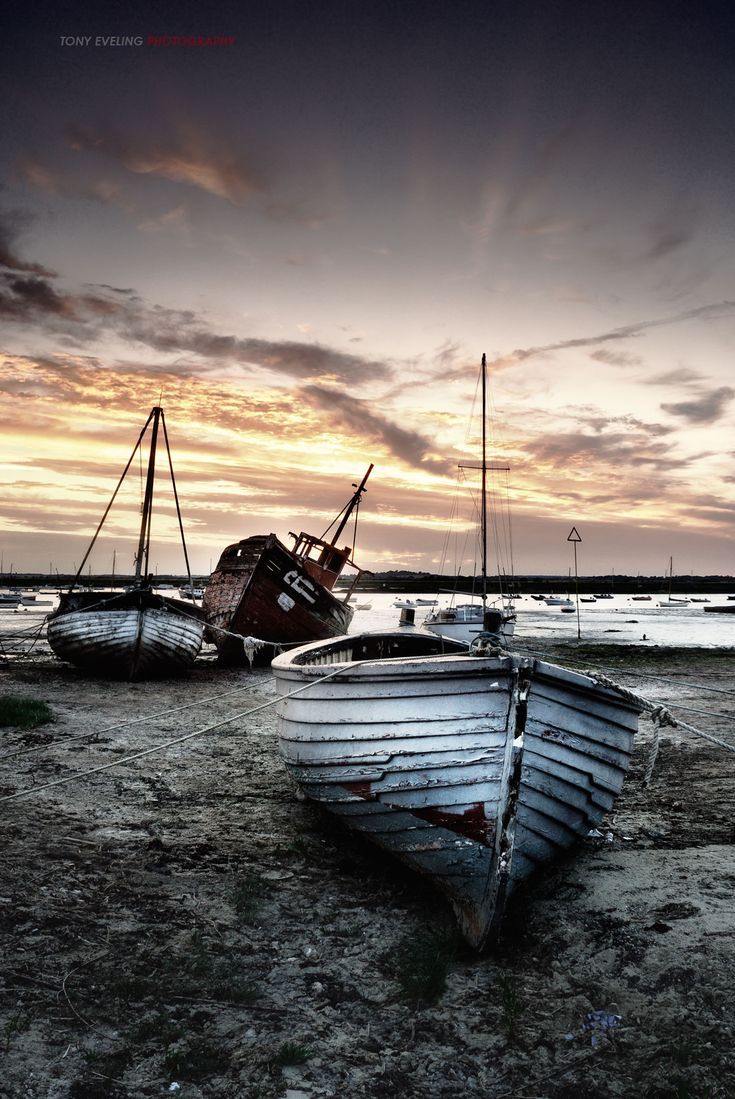 Boats at low tide, Mersea Island, Essex, England, UK. Old wooden boats, decay, weathered, sunset, water, beach, cloudy sky, Ocean view, beauty, photo