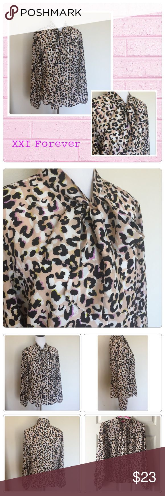 🛍Pastel Cheetah Print Blouse 🛍So pretty in pastel animal/cheetah print, in tans, black, white, and pink. Long sleeve, button up with a tie bow collar. (Ignore my bow tying skills) lol 100% polyester, loose but shaped, and wrinkle free!!  Great for work or play💗be stunning and comfy. Bought and never wore. Just been wasting away in closet. Needs a new home to get love, size Large Offers Welcome through offer button. Happy Poshing!! 🛍 Forever 21 Tops Blouses