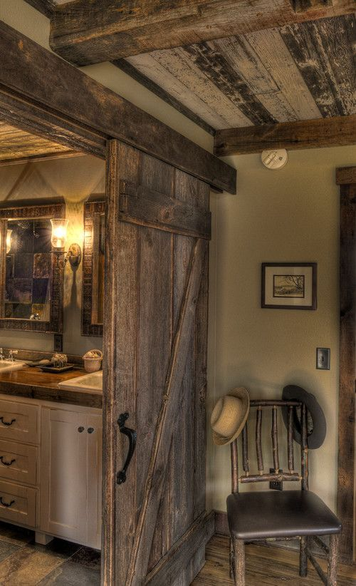 love the barn door between bedroom and bathroom  ceiling is Best 25 Rustic cabin ideas on Pinterest Cabin