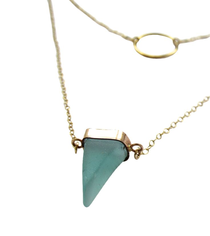 Manifest originality with Sasha. This divine sea glass + gold necklace is handmade with love, with sea glass collected on the shores near the Panama Canal.