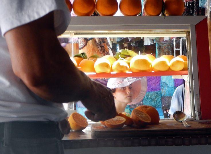 Girl at orange juice vendor, Kekova, Turkey. By Richard Farland.