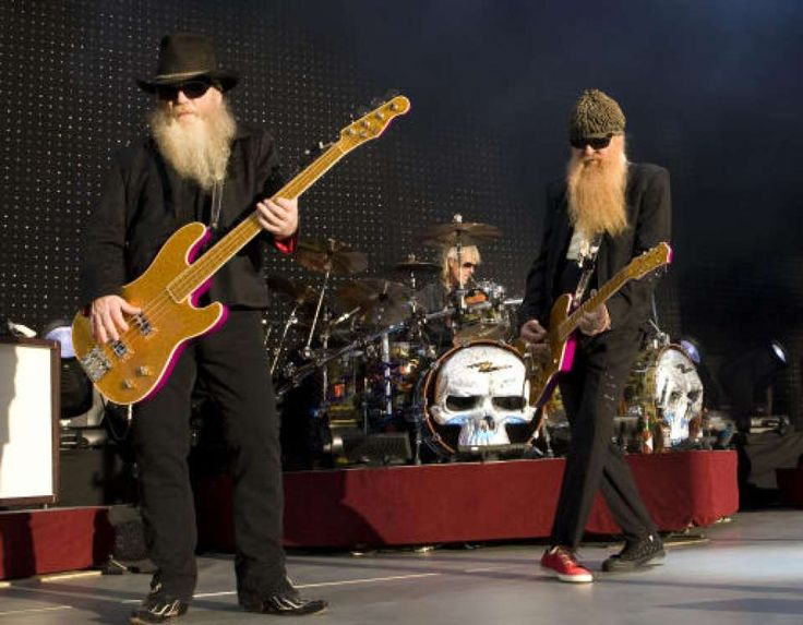 ZZ Top's Dusty Hill, left, and Billy F. Gibbons and Frank Beard, on drums, perform during their concert at the Cynthia Woods Mitchell Pavilion.