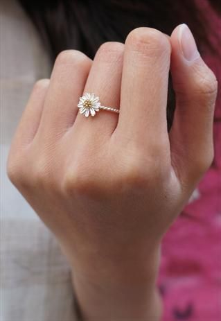 daisy ring. dainty & pretty. My kids give me these often ;) so might as well have one that stays pretty.