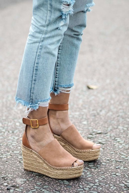 Photo via: EJ Style Emma is not only making us want more raw-hem jeans, but a cool pair of espadrille wedges as well. Her camel Chloé wedges are certainly swoon-worthy and can be worn with a variety o