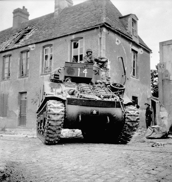 A Sherman tank of the Sherbrooke Fusiliers Regiment, Caen, France, 11 July 1944. Maple Leaf insignia.