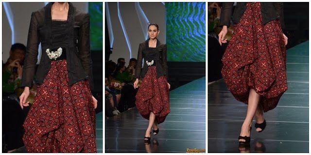 black kutubaru kebaya with modern influences on its skirt