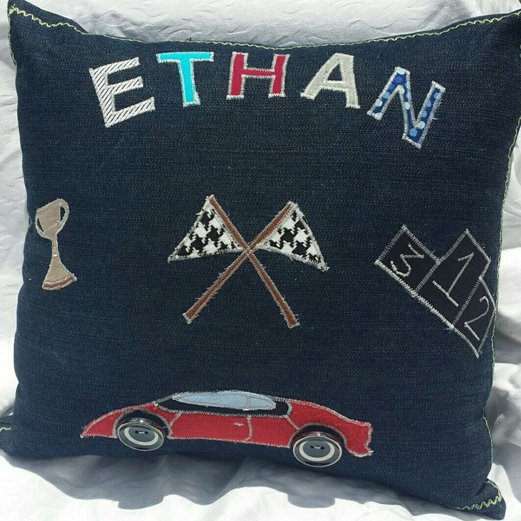 Denim applique throw pillow. Race car themed.