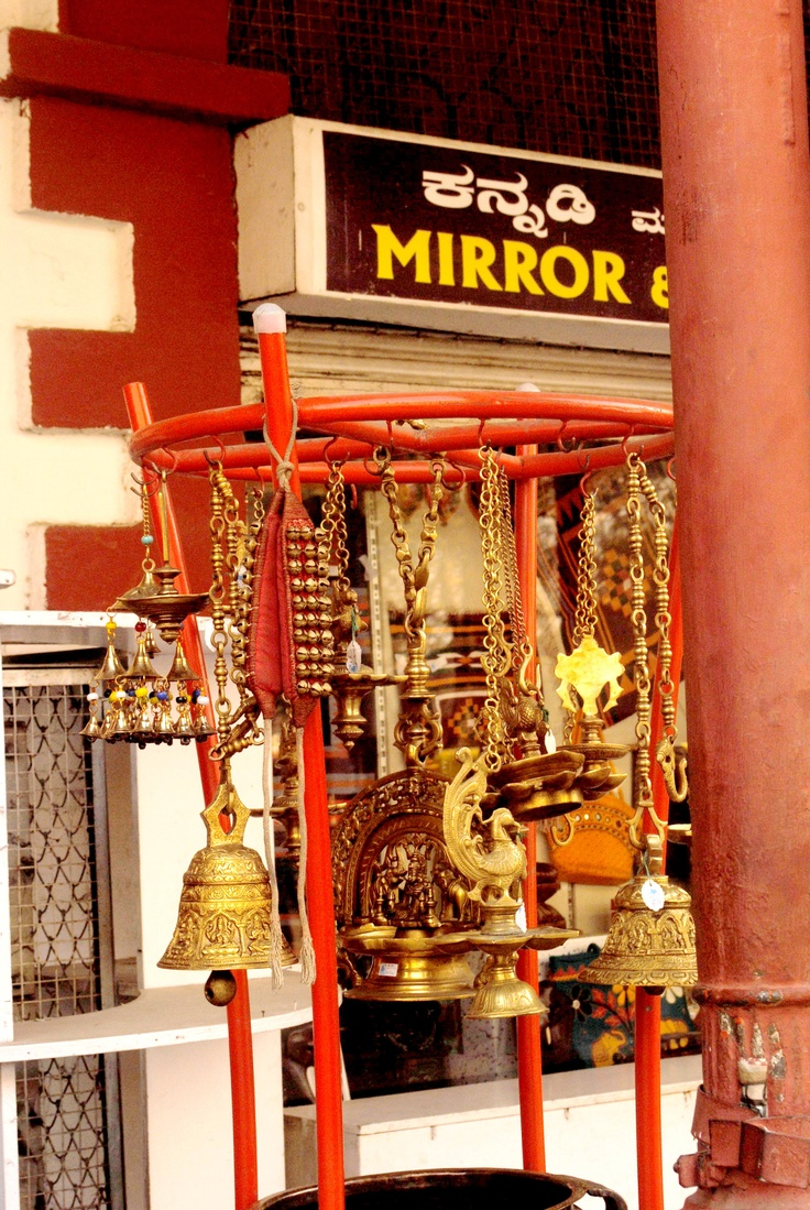 Brass lamps outside Cauvery Arts Emporium
