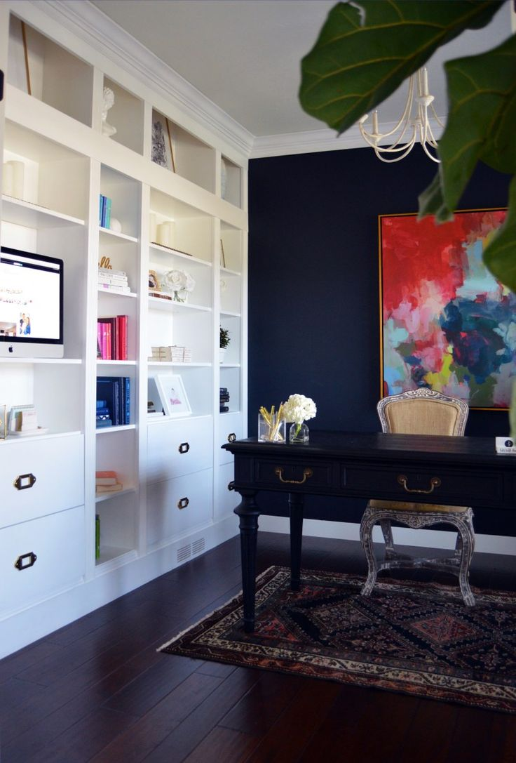 IKEA bookcases turned into custom built in. Dark office painted in Sherwin Williams Inkwell