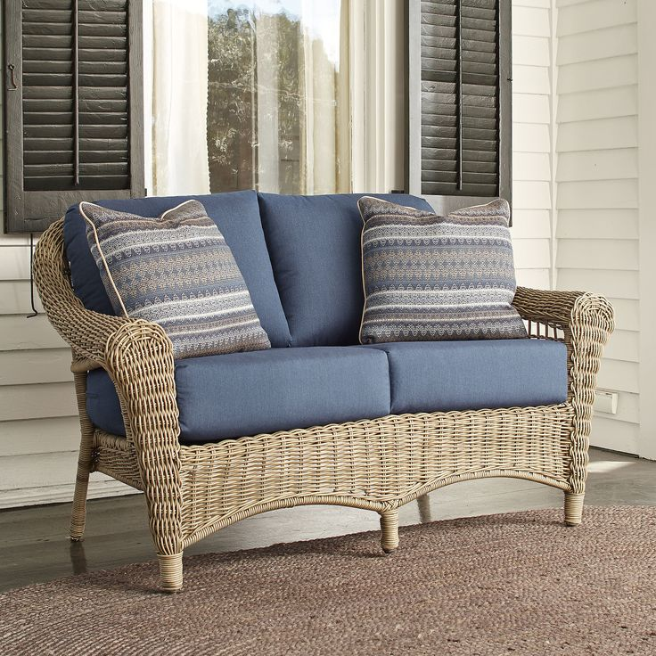 Lynwood Wicker Loveseat with Sunbrella Cushions   Accentuated by rounded sides and arms and ample seating, the Lynwood Loveseat creates the perfect nook to relax in the mid-day sun. Pairing timeless elegance with relaxed island hospitality, the Lynwood Collection features a tightly handwoven wicker design, luxurious deep-seated cushions, and sturdy cast-aluminum framing with non-skid feet to prevent floor damage.