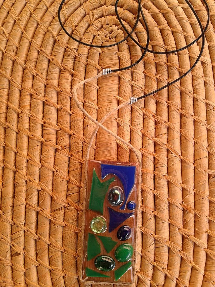 Wooden long necklace with blue and green beads.