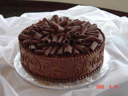 Chocolate Grooms Cake - Chocolate fudge cake w/ choc buttercream and chocolate curls.