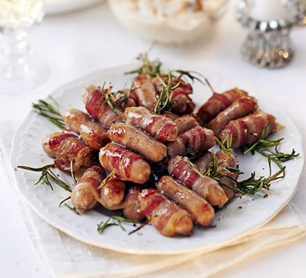Our version of pigs in blankets uses a decorative herb sprig and a drizzle of sweet maple syrup to really bring the traditional side dish to life