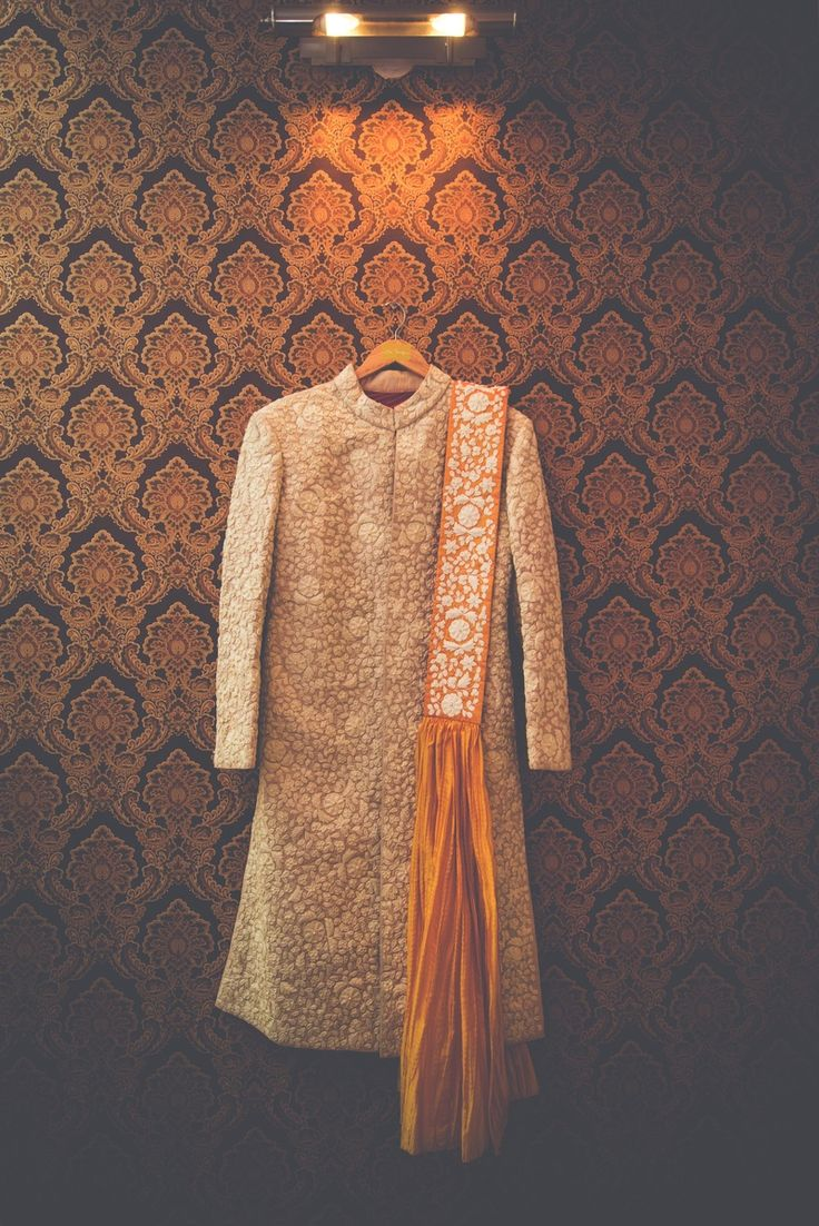 Love this embellished no. for the groom along with that pleated orange detail #IndianWedding #groom #attire | Photo via @LastClick | Curated by #WittyVows - The ultimate guide for the Indian Bride | www.wittyvows.com