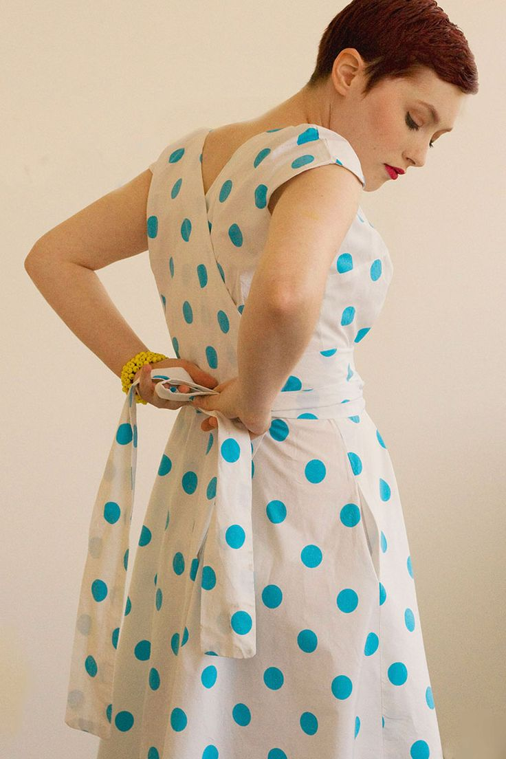 A sweet and easy wrap dress with no closures to sew. The dress wraps in back and has cap sleeves. The wide ties encircle the waist for a comfortable dress with a fitted look. Version 1 has a rounded neckline, while Version 2 has a shaped sweetheart neckline and waist ties in a contrasting fabric.