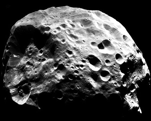 Moons of Saturn : Phoebe Discovery News This hunk of rock circling Saturn under the guise of a moon could have once been a comet. Cassini snapped this photo on June 30, 2004 and researchers have since been studying its unusual pox surface, backwards orbit, low density and extremely dark features. They think Phoebe might have been a Kuiper Belt object close to Neptune before Saturn's gravitational pull snagged it.  CREDIT: CASSINI IMAGING TEAM/SSI/JPL/ESA/NASA
