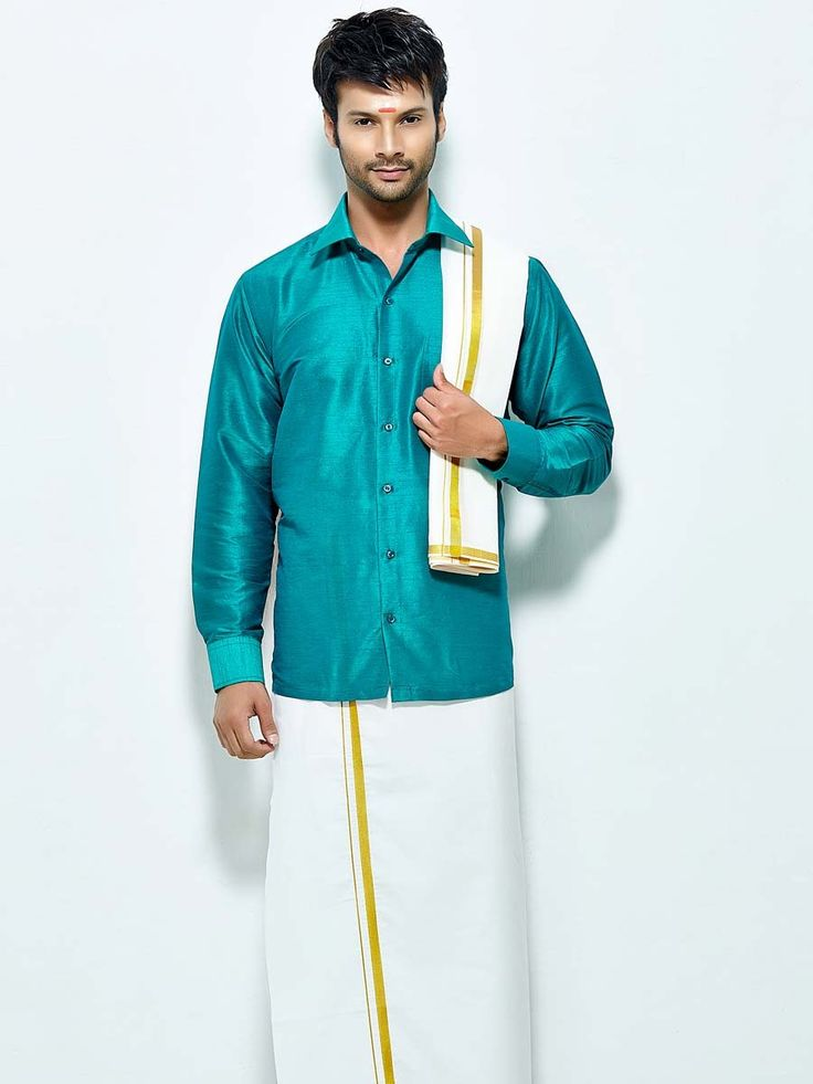 Grandiose teal color raw silk shirt comes with white color cotton dhoti and angavastram. Item Code : SCU12002-13 http://www.bharatplaza.com/new-arrivals/south-indian-mens-wear.html