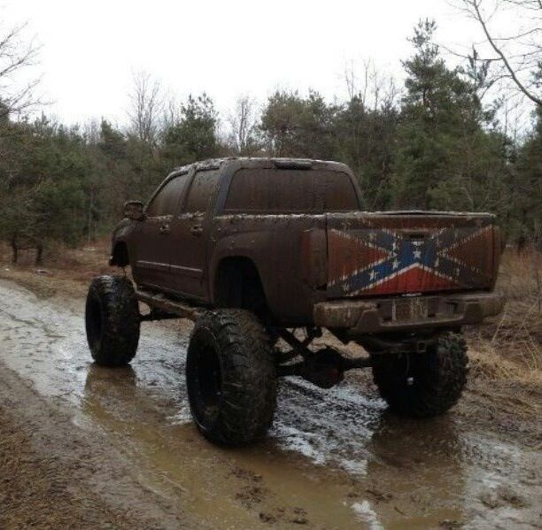 ford trucks mudding lifted. redneck truck i love the rebel flag on tailgate ford trucks mudding lifted