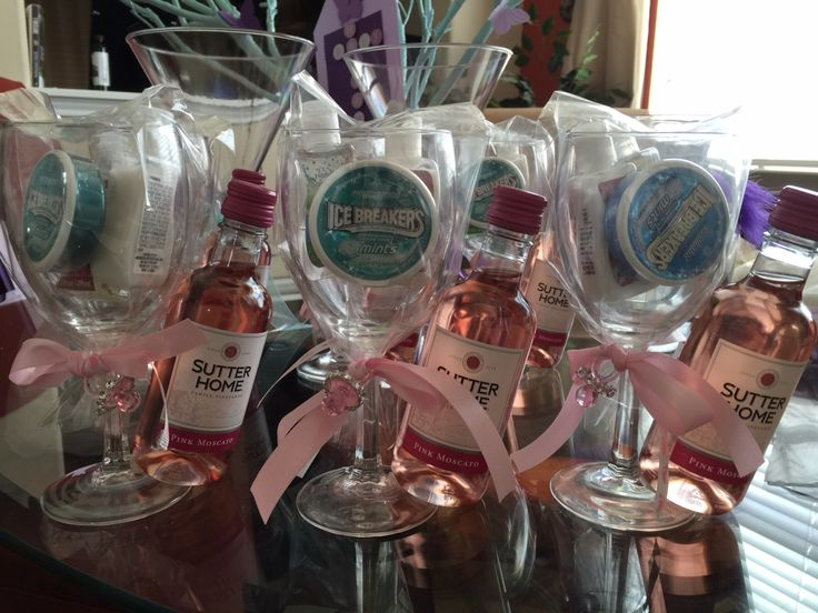 Baby Shower gifts for game winners. I created this gift with Ice breaker mints, hand lotion hand sanitizer in a wine glass with a mini bottle of wine, added some ribbon, #cute-a-licious. Everything except for the wine was purchased from the Dollar store.