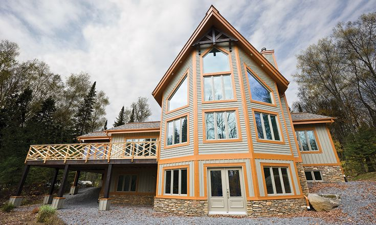 Maibec | Residential project - Laurentides | Siding in our Driftwood-208 color and mouldings in Saddlery-323