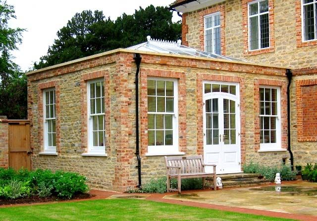 stone built orangery with brick quoins